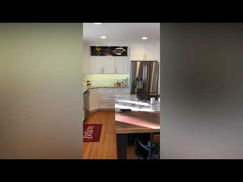 Colorful kitchen completely updated to include a more timeless look. Owners incorporated stainless steel...