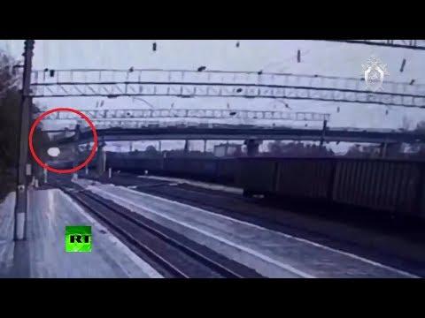 CCTV: Moment bridge collapses on railway as truck drives across it