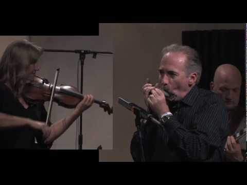 Performing a Finnish folk tune on chromatic harmonica at the 2009 West Coast Jazz Harmonica Summit, with Tuula Cotter on violin.