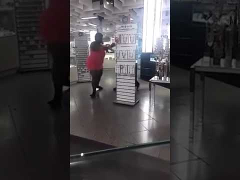 Unclad Sexy lady fighting with the US Police in a shopping mall. Naked