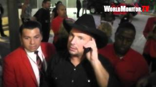 Country legend Garth Brooks surprises a lucky fan leaving Teachers Rock charity benefit