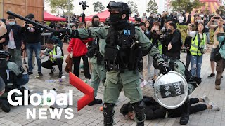 Hong Kong protesters clash with police after Uighur support rally turns violent