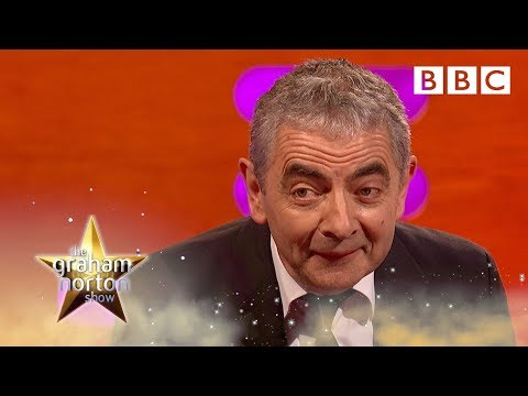 Rowan Atkinson gets half-recognized at a parts warehouse