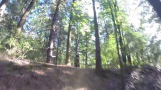 Brandon riding the Mega Pumps Trail's Big Whoops feature at Griffin Bike Park