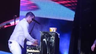 Joe Jonas, Joe Jonas playing piano and Nick Jonas eating popcorn. Raleigh 7/31/13