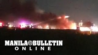WATCH: A Lion Air plane that was taking off at the Ninoy Aquino International Airport on Sunday night burst into flame at the runway with eight people on board. There were no survivors. (Video courtesy of Renvil Perez)