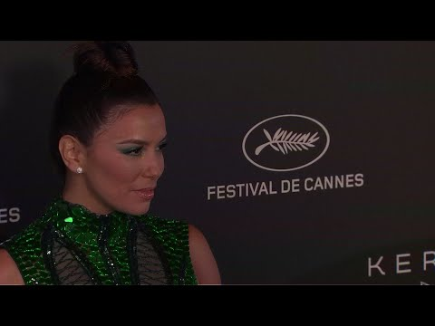 Walking the red carpet for the Women in Motion event at the Cannes Film Festival, Eva Longoria comments on gender parity at the event and addresses the concerns around French actor Alain Delon receiving an award. (May 20)