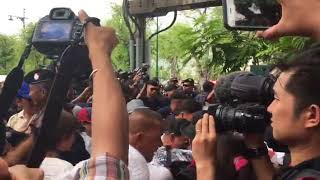 Thai protesters scuffle with police as they try to break through barrier at Thammasat University