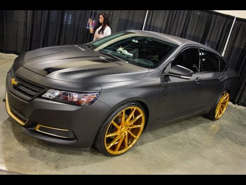 Chevy Impala on Gold and black Vossen Wheels at Am