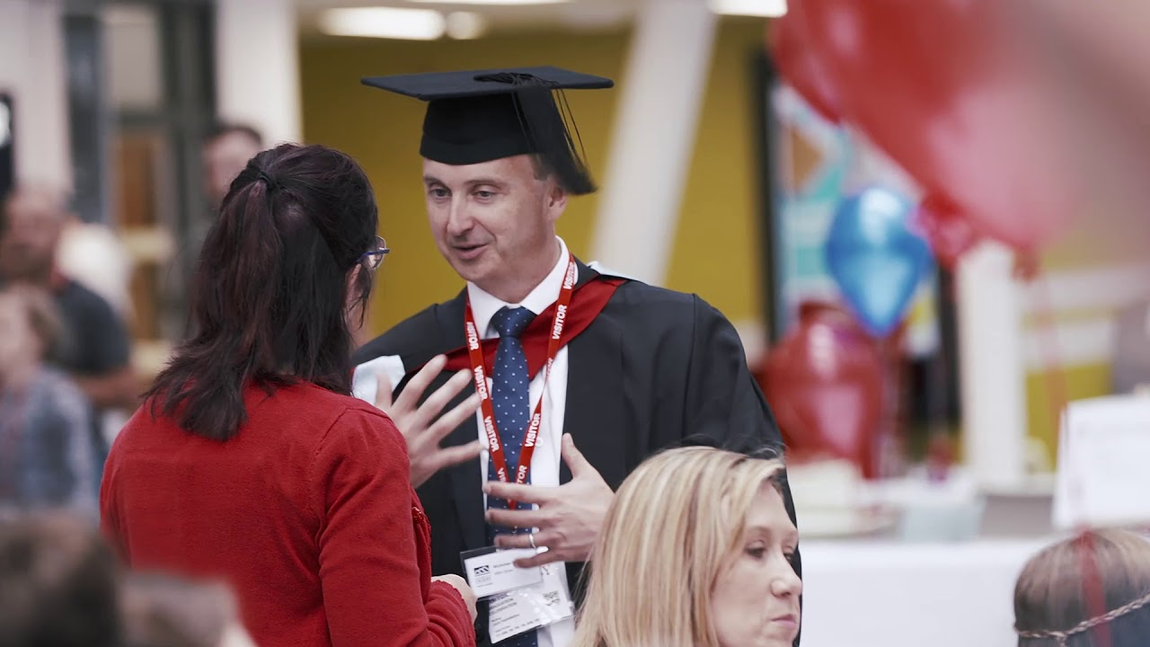 Nicolas Goddard talking about the online MBA Global at the July 2019 graduation reception