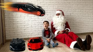 Mark and Santa Claus play with cars. Flying bugatti. Video for kids.