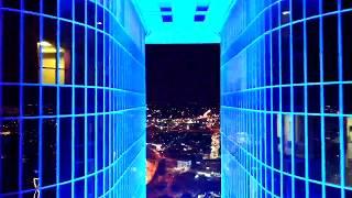 Flying drone into Dallas skyscraper at night - (raw edit)