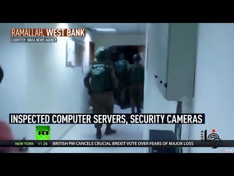 'Intimidation & force': Israeli troops raid Palestinian news agency looking for footage