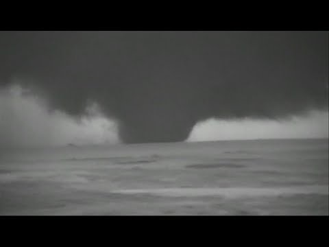 Tornadoes strafed the middle of the country Thursday, this time concentrated in sparsely populated panhandles of Oklahoma and Texas. One particulary large funnel cloud was spotted in Lipscomb County, Texas, near the Oklahoma state line. (May 24)