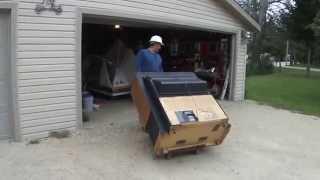 Greg Zanis - Scraping Apart A Big Projection TV