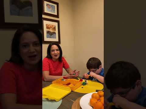 a still shot from the video of Jeanette and Lucas sitting at their kitchen table together