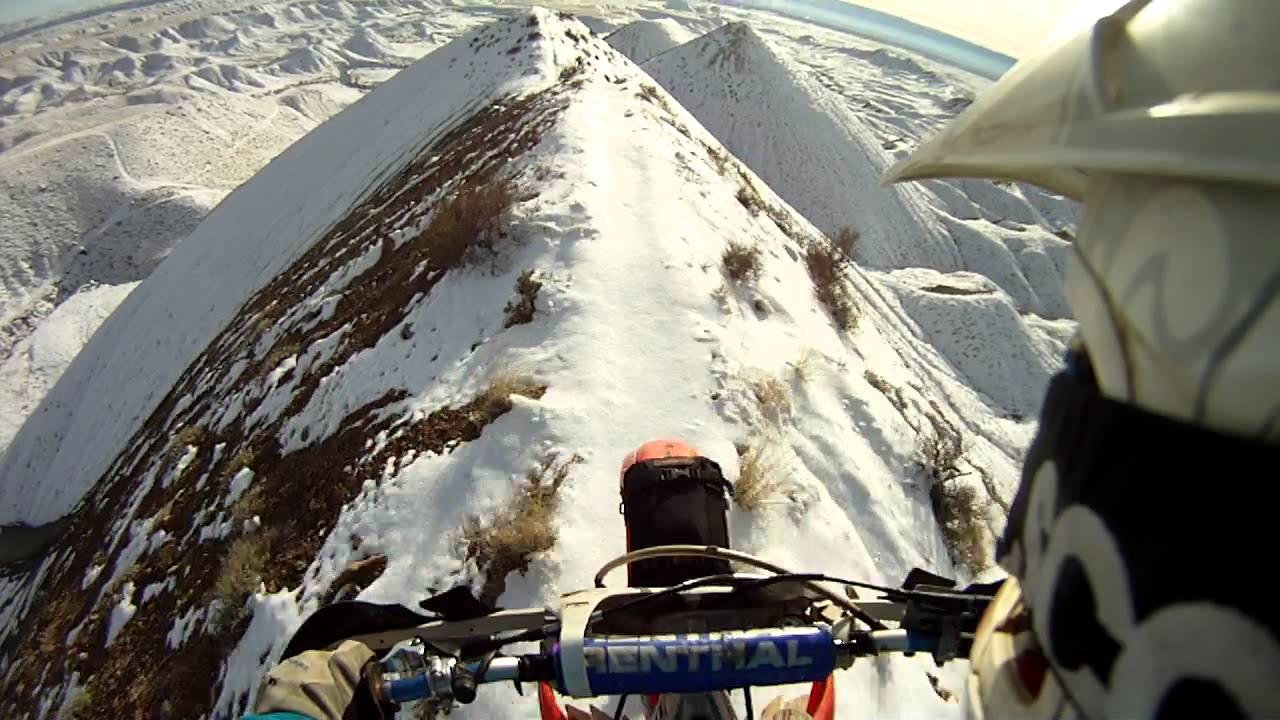 Watch This Crazy Guy Ride His Dirt Bike On A Snowy Mountain Ridge
