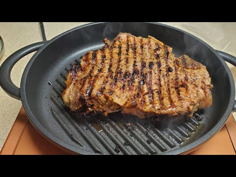 T-Bone Steak on The Whatever Pan Cast Aluminum Griddle with Glass Lid Copper Chef Induction Burner
