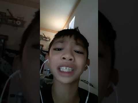 A kid singing  high  hopes