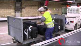 Unloading or loading Baggage between Open Carts and Conveyors - using Vaculex TP BaggageLift