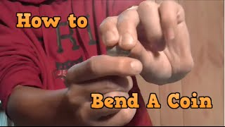 How to Bend a Coin With Your Bare Hands (The Right Way)