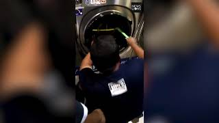 Four year old boy rescued after being caught up inside a washing machine, Malaysia