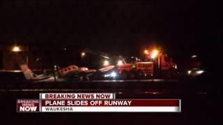Small plane slides off runway at Waukesha