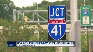 Officer hit by alleged drunk driver while assisting on a crash on I-41