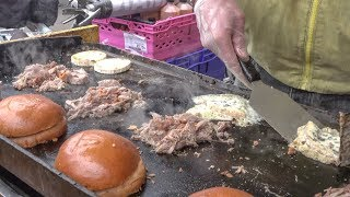 Burger of Duck Pulled Meat and French melted Cheese. London Street Food
