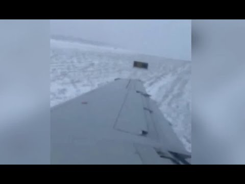 Dramatic video shows plane slide off runway at Chicago's O'Hare Airport due to icy conditions
