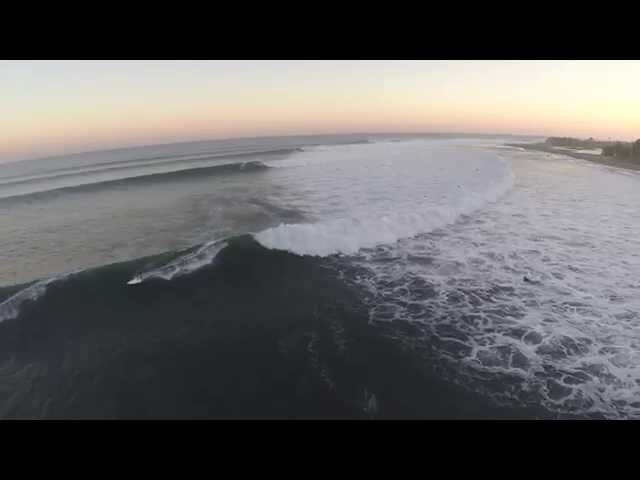 Laird Hamilton SUP surfing epic waves in Malibu!! Shoots the pier twice!!