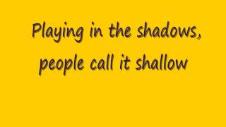 example playing in the shadows lyrics