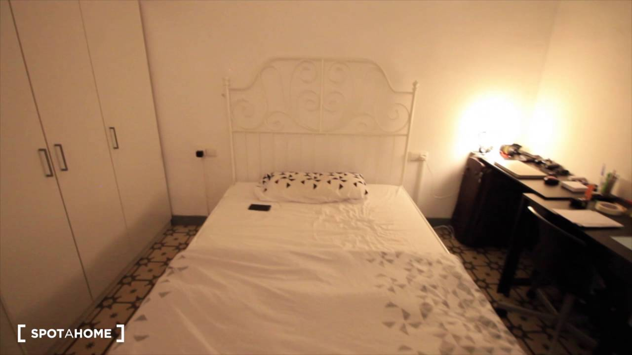 Inviting room with standalone wardrobe in shared apartment, Eixample