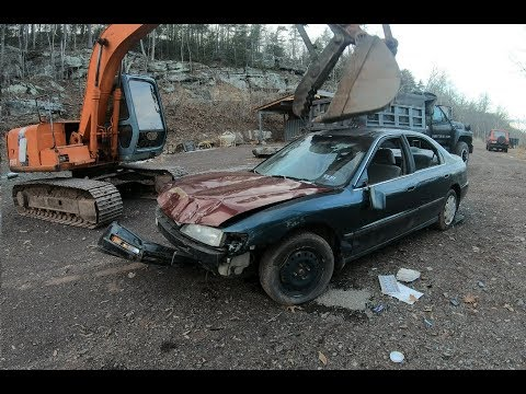 Smashing Car With An Excavator