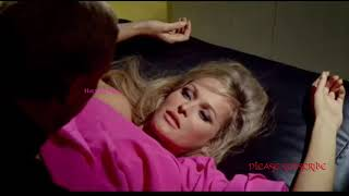 Hot Ursula Andress kissing on bed scene
