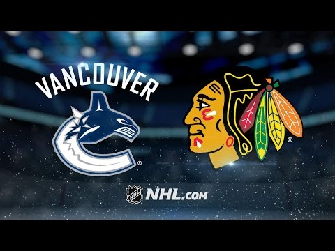 Toews' late goal powers Hawks past Canucks, 4-2