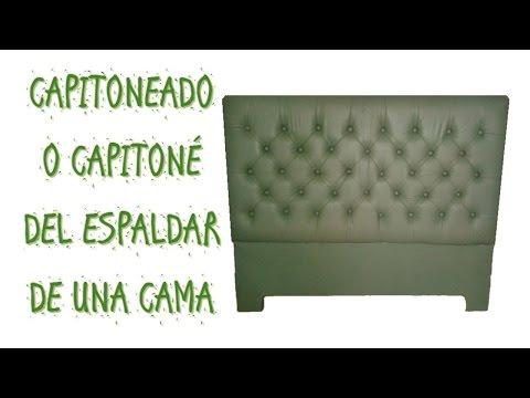 Capitoneado o Capitoné en cuero de una cabecera de una cama