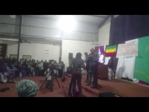 South African pastor burns SA flag and constitution saying South Africa Must Fall.