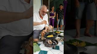 Art making an omellete in Vietnam