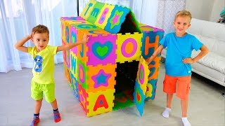 Vlad and Nikita pretend play and build colored Playhouse
