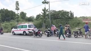 Người đàn ông chết bên cạnh chiếc xe máy ven đường