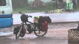 preview picture of video 'Zambia, bicycles suffer from hard tropical rains'