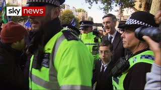 Protesters heckle Jacob Rees-Mogg and young son