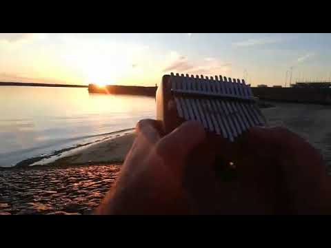 Reading a book and playing Kalimba on the Beach