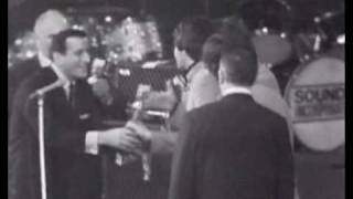 Beatles Accept NME Award (John/Paul Hug)
