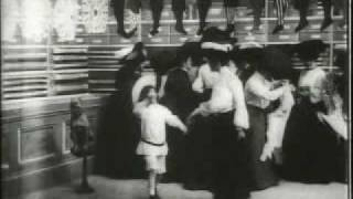 1904 Buster Brown Makes Room for his Mama at the Bargain Counter