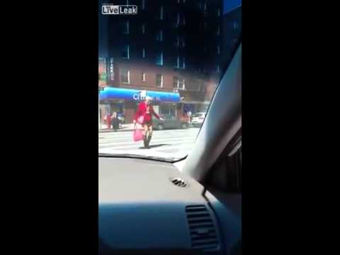 MUST WATCH! Senior Citizen Wobbles In Heels While Crossing A Busy New York Street