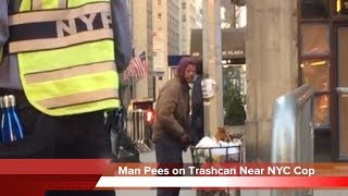 Man Urinates On Trashcan Next To NYC Cop