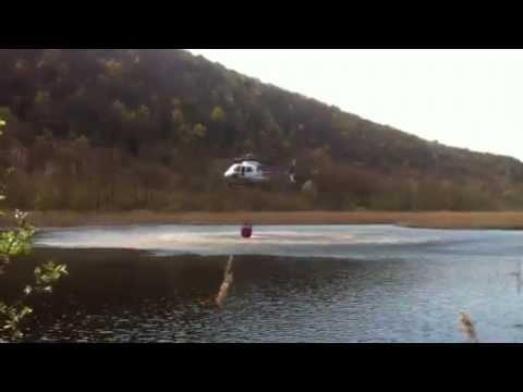 Incendio in Valganna, elicottero in azione
