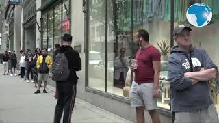 Customers line up as shops reopen in downtown Montreal, Canada